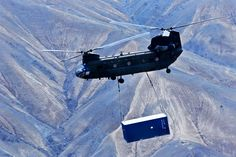 CHINOOK SHIPPING - A U.S. Army CH-47 Chinook helicopter carries a shipping container during retrograde operations and base closures in Afghanistan's Wardak province, Oct. 26, 2013. U.S. Army photo by Capt. Peter Smedberg