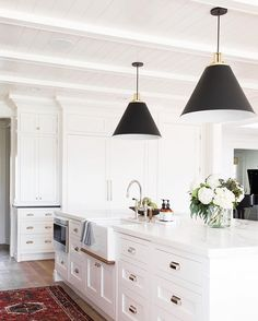 """A classic foundation with modern touches."" Shea & Syd of @studiomcgee used our Butte Cone pendants & Hexagonal Bin pulls in this kitchen remodel to make their client's vision come true. Link in profile to see the before & after photos of this whole home remodel. Photo by @kateosborne #myonepiece #kitchenremodel #windsongproject #pendantlighting #mcgeeandco"