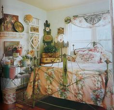 Cottage chic bedroom...vintage florals, oil paintings.