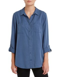 This oversized inspired shirt is a cool chambray tone. The button front style has full length roll up sleeves with button & tab options, front pockets, curved hem, and a cool button back detail. A great match with skinny pants. Cool Buttons, Womens Clearance, Plunge Bra, Roll Up Sleeves, Skinny Pants, Chambray, Tunic Tops, Pockets, Inspired