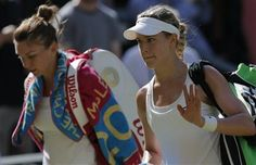 Eugenie Bouchard of Canada, right, waves as she walks off court with Simona Halep of Romania after she won their women's singles semifinal match at the All England Lawn Tennis Championships in Wimbledon, London, Thursday, July 3, 2014. (AP Photo/Pavel Golovkin) ▼3Jul2014AP Tennis' Bouchard might 'Never Say Never' to Bieber http://bigstory.ap.org/article/bouchard-bieber-how-you-me-now #The_Championships_Wimbledon_2014 #Eugenie_Bouchard #Simona_Halep