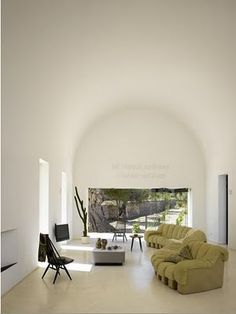 Barrel vaulted living room inside a villa in Ibiza by Pascal Cheikh Djavadi.