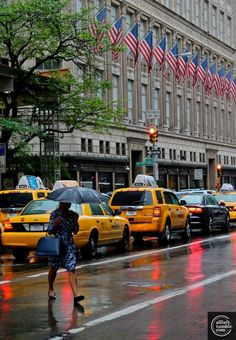 Crossing Fifth Avenue north of 50th Street; that's Saks Fifth Avenue with the flags