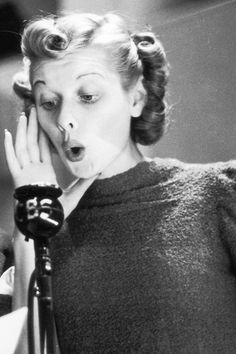 Lucille Ball performing for a radio broadcast, 1940, photo by Gene Lester