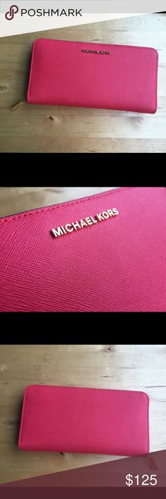 Michael Kors Leather Travel Wallet Michael Kors Leather Travel Wallet in Coral Reef Pink Color!  100% Authentic with tags. It's bigger then the regular wallet. Super fun, super comfortable! Make it yours while you can  Michael Kors Bags Wallets