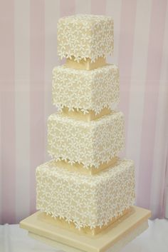 4 tier, square wedding cake with a floral lace covering