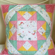 Beautiful quilted pillow featuring the Saltwater collection designed by Cinderberry Stitches #iloverileyblake #fabricismyfun