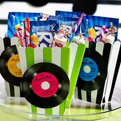 "Give '50s theme party favors a new spin:  retro candy boxes in candy-shoppe stripes with 'vinyl"" details added!"