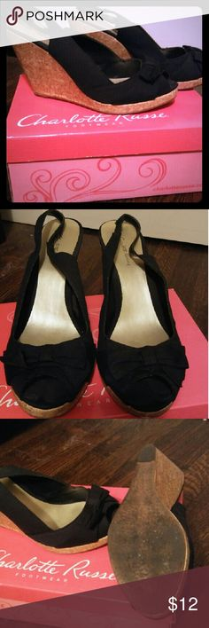 Black sling back wedges Charlotte Russe. Worn once. See pics for signs of wear on bottom of shoes. Great condition. Back strap is not adjustable. Charlotte Russe Shoes Wedges