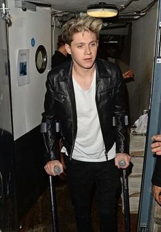 My poor baby on crutches!!!   My lil Nialler I hope u get well soon!!!