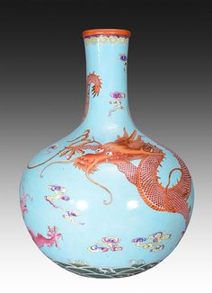 A VERY RARE LARGE FAMILLE ROSE TURQUOISE-GROUND BOTTLE Qing Dynasty. The vase is pear-shaped. The exterior is decorated with imperial designs, ruyi clouds, and a large dragon in the surrounding blue sky. On the bottom the vase has a Chinese seal and have various bright and happy glass colors 19 7/8 in tall.