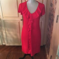 stunning red dress Only worn and washed once. In perfect condition. 95%polyester,5%spandex. Measures 17 inches from armpit to armpit and 37 inches from shoulder to hem. Smoke and pet free home. Dresses Midi