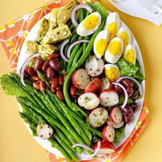 Veggie Nicoise Salad Recipe -More and more people in my workplace are becoming vegetarians. When we cook or eat together, the focus is on fresh produce. This salad combines some of our favorite ingredients in one dish . . . and with the hard-boiled eggs and kidney beans, it delivers enough protein to satisfy those who are skeptical of vegetarian fare. —Elizabeth Kelley, Chicago, Illinois
