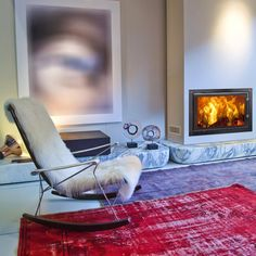 Contemporary wood burning inset stoves with a large window. Insert Stove, Barcelona Chair, Large Windows, Stoves, Couch, Contemporary, Wood Burning, Furniture, Design