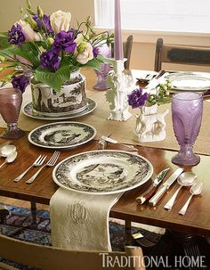 Transferware from Villeroy & Boch dresses the dining table. Purple glasses and candlesticks inject color. - Traditional Home ® / Photo: Werner Straube / Design: Rebecca Yuhasz Smith