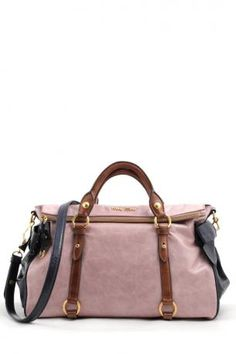 Miu Miu Bag -Vitello Lux Bauletto bag by miu miu in pink blue and brown color- bauletto bag in shiny leather in pink and blue color, two brown leather handles, a detachable leather shoulder strap in blue color. Zipped closure. Black cotton satin lining. Inside, a large zippered pocket, a mobile phone pocket and two open pockets.    Height: 22 cm. Width: 37 cm. Depth: 21 cm. Handle Height approx.: 11 cm. Shoulder strap length approx.: 100 cm.