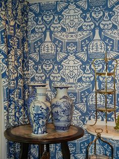 Love the wallpaper, curtains, and blue and white