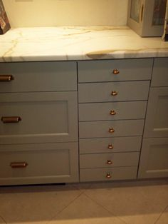 grey cabinets brass hardware - love these two tones together = grey/brass = love @Courtney Leigh Diaz