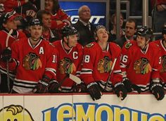 CHICAGO, IL - FEBRUARY 19: (L-R) Patrick Sharp #10, Jonathan Toews #19, Patrick Kane #88 and Dave Bolland #36 of the Chicago Blackhawks celebrate a goal by Kane in the shootout against the Vancouver Canucks at the United Center on February 19, 2013 in Chicago, Illinois. The Blackhawks defeated the Canucks 4-3 in a shootout. (Photo by Jonathan Daniel/Getty Images)