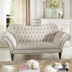 Fanciful with ornate detail, lovers of all things tufted and feminine will fall for the Bostwick Loveseat's old-world appeal. Updated with simple beige linen rather than obsolete richly-colored brocade, this loveseat is perfect for the modern home.