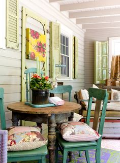 While Amanda's whole home is an ode to color, she chose to deviate from her ordinary hues on the porch. From the shutters to the painted chairs, green and purple hues showcase just the right amount of boldness.    - CountryLiving.com