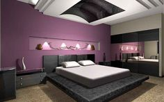 This space represents a bedroom in shades of purple. The room is ample, with orchid walls. There are many spot lights providing a romantic atmosphere. The bed is grey dark, in contrast with the serenity of the walls. The night table is grey dark, too. The carpet is café au lait and provides equilibrium to the room