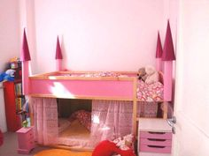i'm not crazy about the pink castle, but i love this idea to turn a bunk bed into a playhouse