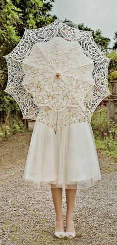 Lace parasols are fantastic way to accent vintage wedding attire. #parasols #VintageWedding