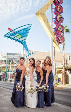 Bride and her maids under the retro neon of Fremont during the day   Party Rockin' Wedding Above Las Vegas {The Ogden}   Photo: @Josh Lam and Jen Photography