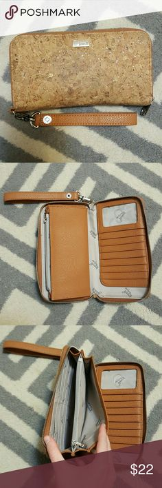 Thirty One large wallet Thirty One large wallet, Jewel by Thirty One, brown cork, used but great condition, comes with wristlet attachment. Thirty One Bags Wallets