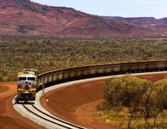 Pilbara Trains -- Rio Tinto's iron ore heading to the coast for export. Iron Ore, Steamers, Men Stuff, Locomotive, Trains, Rio, Landscaping, Coast, Country Roads