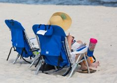 Since you'll be taking your chairs with you at the end of the day, consider chairs with a backpack component. The straps make them easy to carry to and from the beach. Beach blankets, sheets and towels are also great options and don't take up a lot of space in your luggage when packing. Inflatable lounge chairs and ground hammocks are a great option, as well