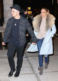 Holding hands: Jennifer held hands with boyfriend Casper Smart, who watched the show backstage, after the taping