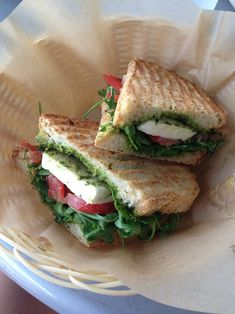 .This is so simple yet looks so good and healthy too. It looks like fresh mozzarella, tomato, lettuce and some pesto on toasted bread yum!