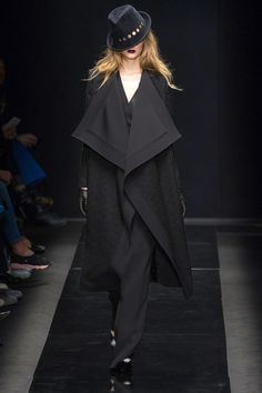 It wasn't just Le Smoking done 20 ways or glitzy gowns, thankfully, but elements of the tuxedo pulled out and focused on. A wool coat featured the blown up lapels of a penguin suit. Elsewhere, a white jumpsuit and cloak riffed on formal coattails.   - HarpersBAZAAR.com