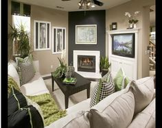 Funky family room!  i really like this theme..... would it work w the brick wall, black ceiling beams, etc?  stain the concrete floor grey or black? with a huge black sectional!!  @Kandice Poirier