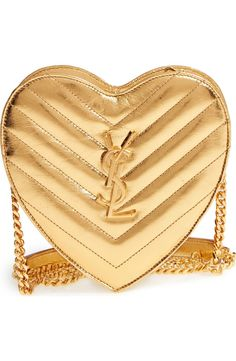 Quilted metallic-leather construction underscores the glamorous look of this heart-shaped crossbody bag fashioned with a gleaming chain-link crossbody strap.