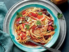 Slow-Cooker Chicken Cacciatore with Spaghetti | Spend 20 minutes in the kitchen prepping this gorgeous, hearty sauce. Once the sauce simmers in the cooker, all that's left to do is cook a pound of pasta, and serve.