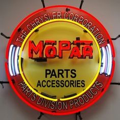 Mopar Parts/Accessories Neon Sign with Silkscreen Backing featuring multi-colored, hand blown neon tubing. The glass tubes are supported by a black finished metal grid which can be hung against a wall or window. It can even sit on a shelf. These neon signs have a warm mesmerizing glow and are powered by industrial strength transformers which operate silently and more efficiently than incandescent bulbs. All you do is hang it up and plug it in with no assembly or special wiring required…
