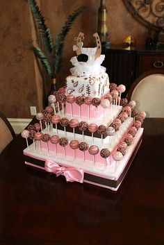 Beautiful pink and brown cake pops display #wedding #weddingdessert…