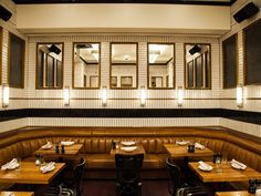 With materials such as wood, zinc, and tile, Roman and Williams created Kingside, a classic American eatery in midtown Manhattan. The restaurant's striking black-and-white-checkered floor has red grout, and the walls throughout are covered in mirrors.