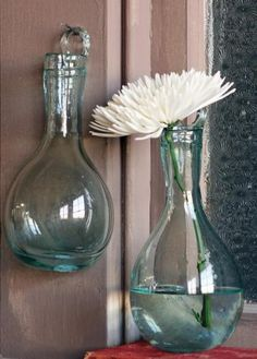 Recycled Teardrop Wall Vase by Kalalou. $25.00. Glass Hook for Hanging. Made from hand blown recycled glass,  these thick and unique wall vases were purposefully created with a glass hook to be hung from a wall or window, but serve perfectly as a traditional vase atop a desk or mantle.. Made from Recycled Glass. Sold Individually. Made from hand blown recycled glass,  these thick and unique wall vases were purposefully created with a glass hook to be hung from a ...