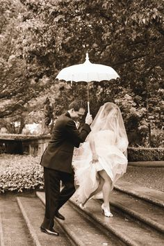 Although rain is not ideal for a wedding day, it certainly can add to the beauty of an image, especially when printed in rich sepia tones.
