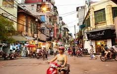 Hanoi's bustling Old Quarter buzzes with activity all day long. Come early to browse the food markets in pe.
