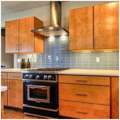 Explore these kitchen design trends whether you need to get inspired for a simple refresh or are planning to remodel your entire kitchen. Retro Appliances, White Appliances, Retro Kitchens, Wooden Countertops, Wooden Cabinets, Kitchen Cabinets, Updated Kitchen, New Kitchen, Retro Stove