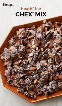 Sweet, chocolaty Chex™ mix, packed with chunks of real Heath™ bars and crunchy roasted almonds, is one party snack that's sure to disappear fast. Thank goodness this recipe makes loads. (Who knows—you might even decide to share. Puppy Chow Recipes, Snack Mix Recipes, Yummy Snacks, Delicious Desserts, Healthy Snacks, Dessert Recipes, Snack Mixes, Candy Recipes, Chex Recipes