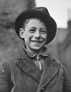 Ten year-old Shamus O'Brien, mascot of the 'Dead End Kids' - a gang of teenage boys from the East End of London, who worked as unofficial fire fighters during the Blitz, April 1941. Original publication: Picture Post - 721 - Dead End Kids - unpub. (Photo by Bert Hardy/Hulton Archive/Getty Images)