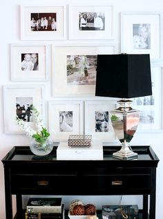 Entry Table In Chic Black Accentuated With A Black And White Wall Gallery. Added Sparkle Of A Silver Base Lamp Home Decor Inspiration, Decor, Interior Design, Decor Inspiration, Home Accessories, Home Remodeling, Home, Interior, Home Decor