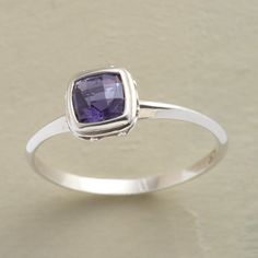 ACCENT ON IOLITE RING -- Checkerboard facets distinguish our ring's iolite gem. Sterling silver band. Exclusive. Whole and half sizes 5 to 9.