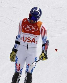 United States' David Chodounsky reacts after racing Britain's Laurie Taylor in the alpine team event... - (AP Photo/Christophe Ena